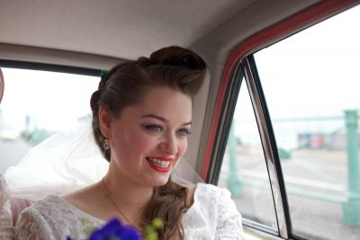 Quiff, red lips and eyeliner bride make up