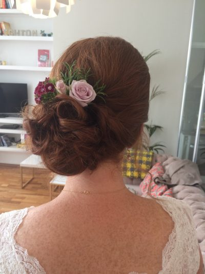 Side bun flowers wedding hair