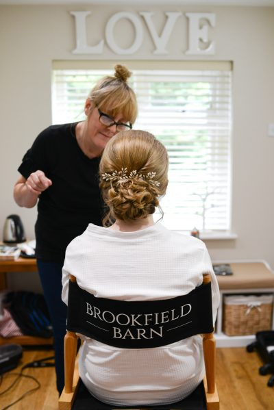 Wedding hair bun at Brookfield Barn