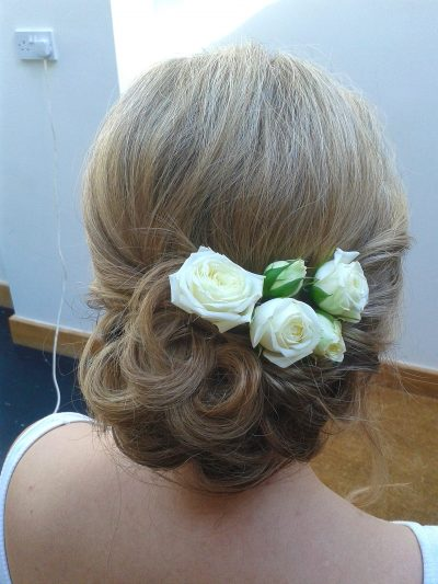 neat chignon fresh flowers